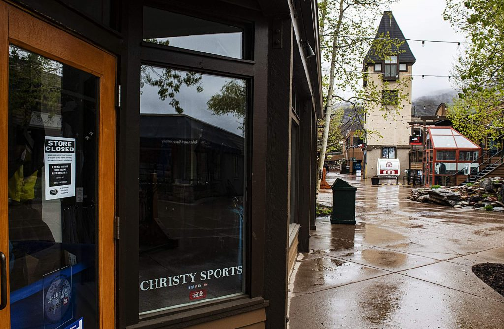 Christy Sports tells passersby that they're closed with a sign in the window on the Snowmass Village Mall on Monday, May 11, 2020. (Kelsey Brunner/Snowmass Sun)
