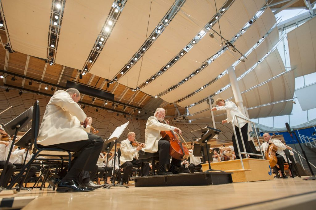 """Cellist Lynn Harrell performs Augusta Read Thomas's Cello Concerto No. 3 """"Legend of the Phoenix"""" with the Aspen Festival Orchestra, led by conductor Christian Arming, on July 25, 2014, inside the Benedict Music Tent in Aspen."""