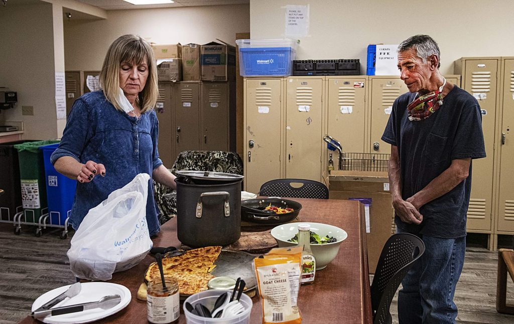 Jolanta Weiss bags up some of the meal she made for the clients at the Aspen Homeless Shelter on Tuesday, May 12, 2020.
