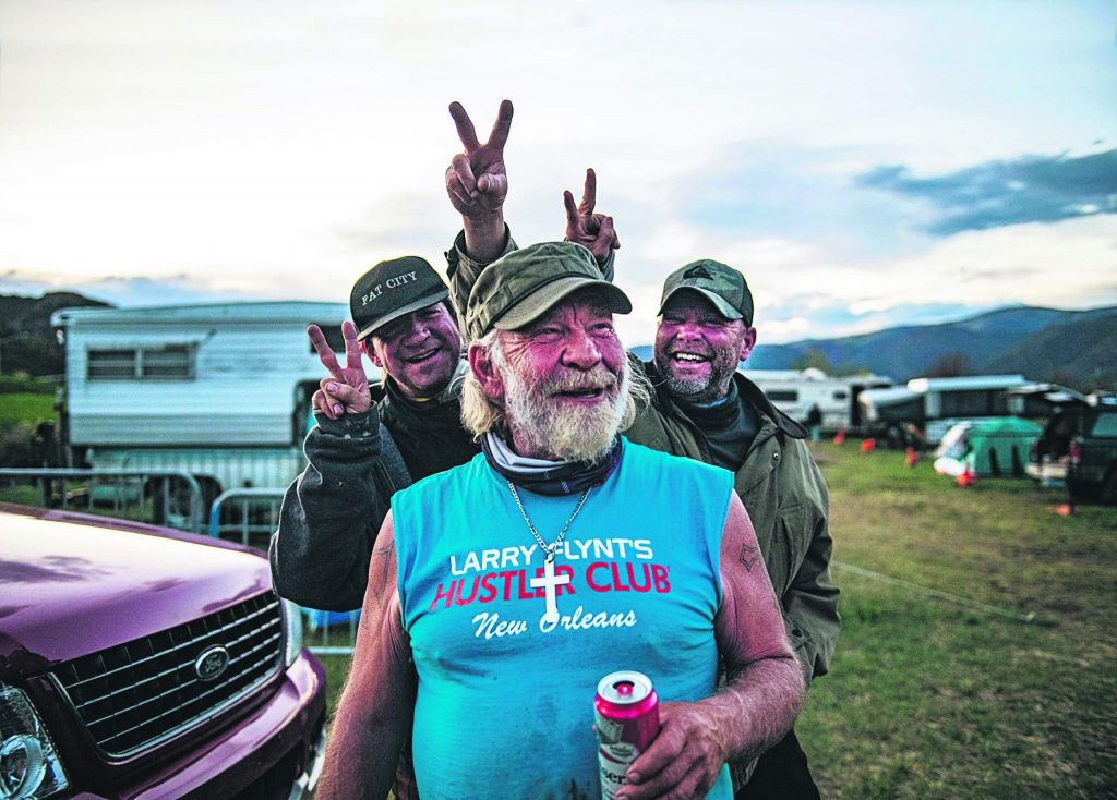 """Charlie, left, and Vince Thomas, right, prank their friend and camp manager James Hoge at the homeless camp across from the Intercept Lot in Aspen on Tuesday, May 12, 2020. """"This is my troop,"""" said Hoge. """"These are my people. I respect and love them was much as they respect and love me."""""""