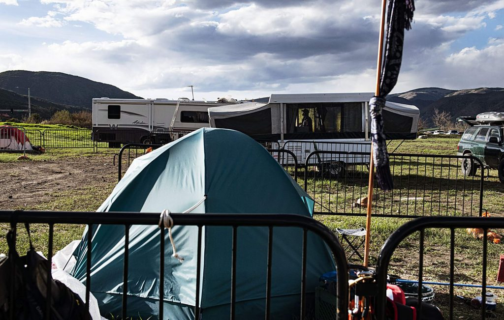 Landon Hartstein walks around his camper at the homeless camp in Aspen on Wednesday, May 13, 2020.
