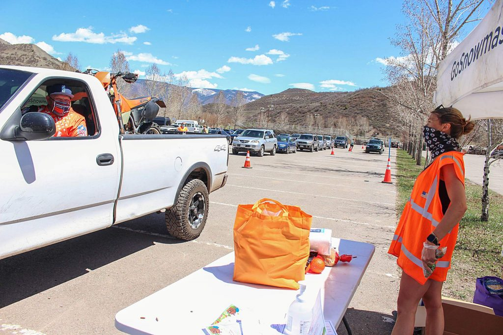 Allison Welsh helps give out free food at the first food distribution day in Snowmass Village on May 1, 2020. The next distribution will be Friday, May 15 from 12 p.m. to 2 p.m.
