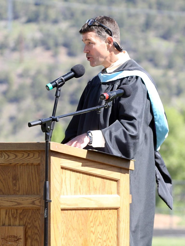 Principal Peter Mueller gives introductions during the Basalt High School graduation ceremony on Saturday, June 1, 2019, on the BHS football field. (Photo by Austin Colbert/The Aspen Times)