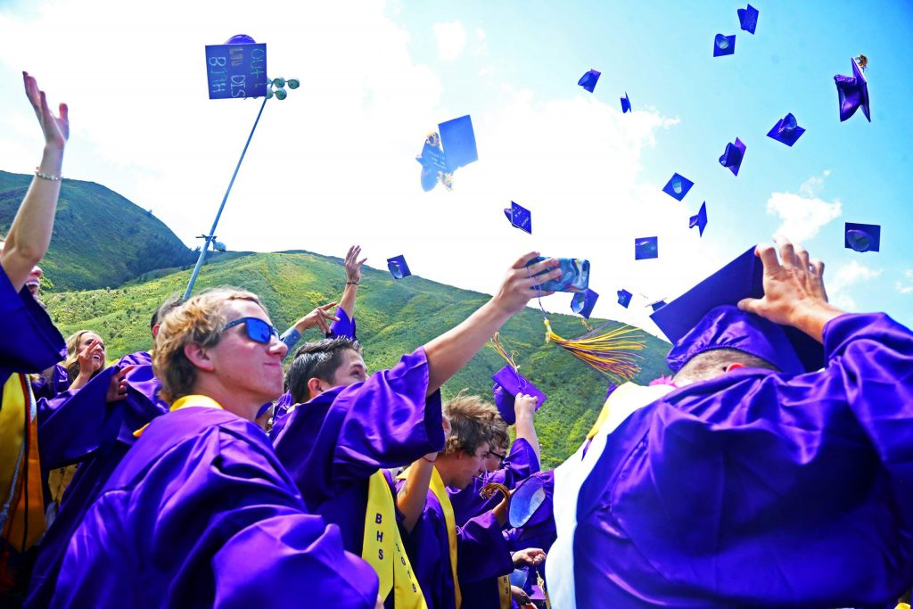 Students celebrate with the traditional cap toss to close out the Basalt High School graduation ceremony on Saturday, June 1, 2019, on the BHS football field. (Photo by Austin Colbert/The Aspen Times)