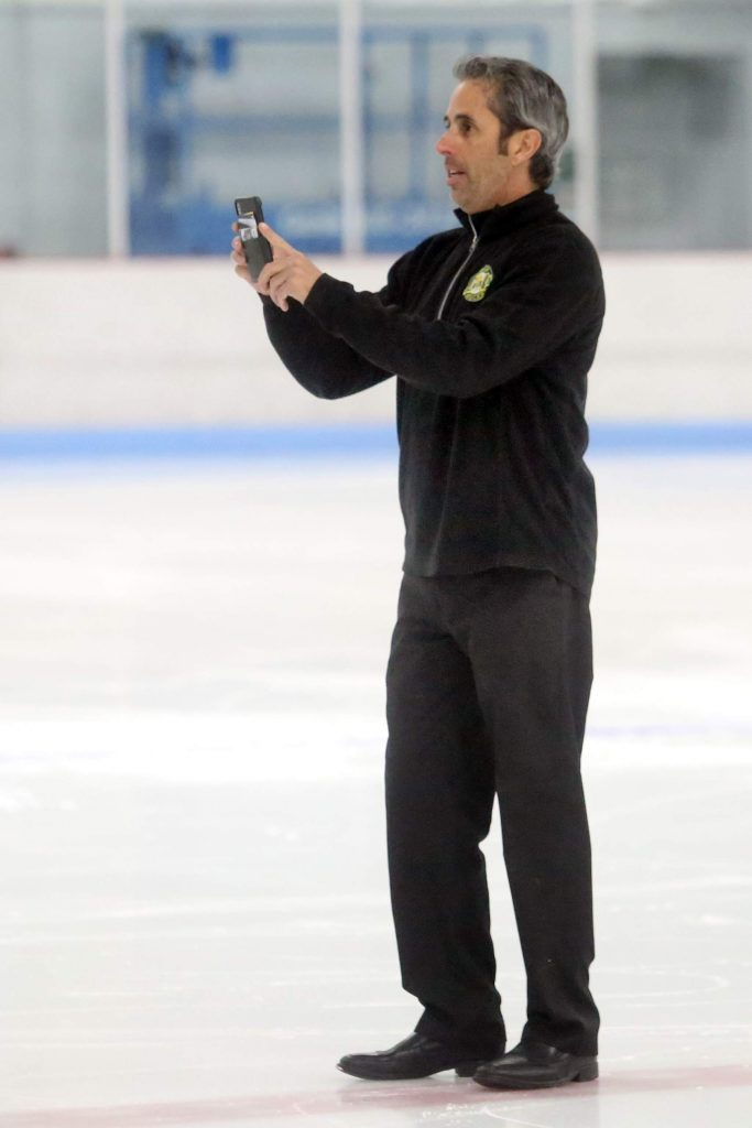 Former Aspen Junior Hockey executive director Shaun Hathaway takes pictures during a Stirling Cup hockey game on Saturday, Sept. 22, 2018 at Lewis Ice Arena. (Photo by Austin Colbert/The Aspen Times).