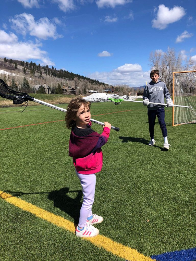 Anna Light, with older brother Casey Light, shows off the new gear she received through the Aspen Lacrosse Club's new