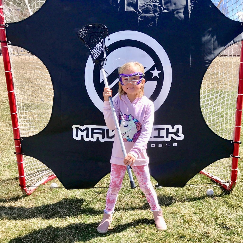 Eleonore Elwell Sauder shows off the new gear she received through the Aspen Lacrosse Club's new