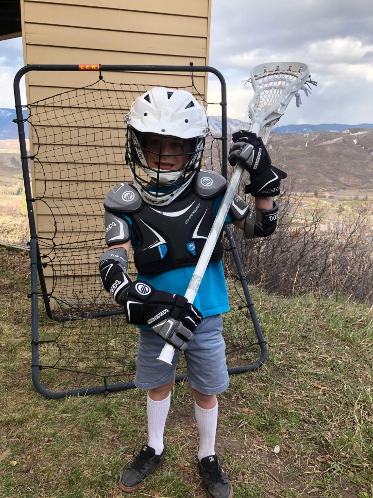 Ansel Stokes shows off the new gear he received through the Aspen Lacrosse Club's new