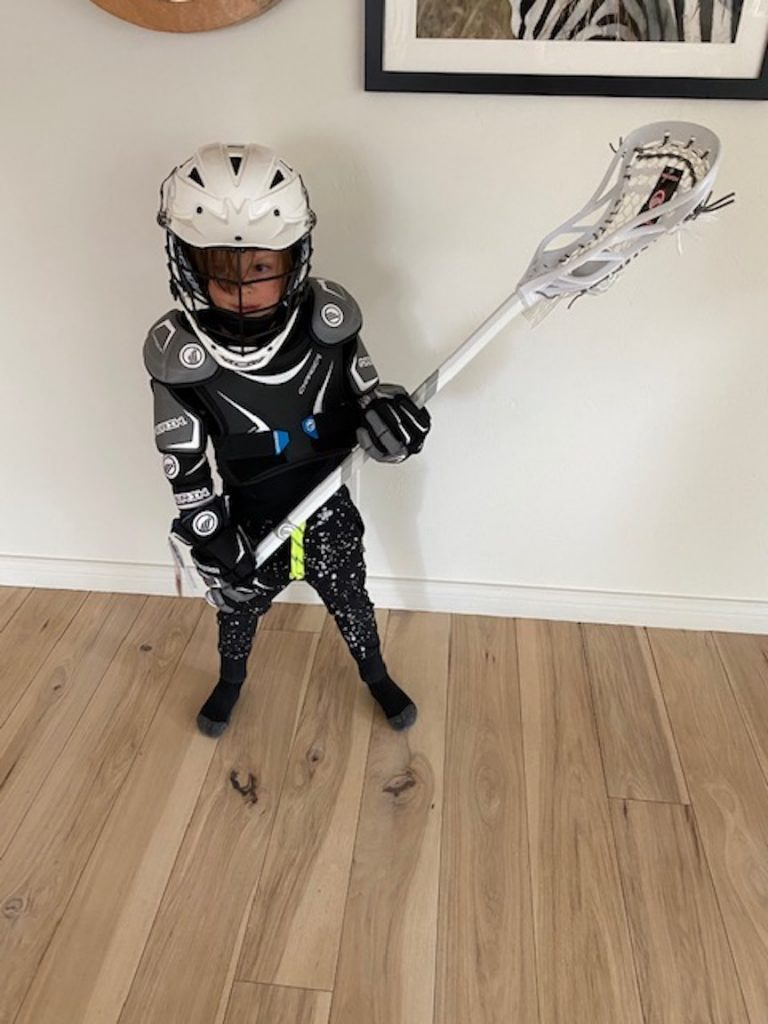 Eli Davenport shows off the new gear he received through the Aspen Lacrosse Club's new