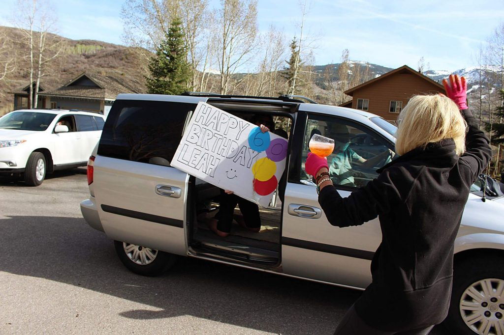 Friends greet Leah Moriarty with a happy birthday sign on Sunday, May 3, 2020.