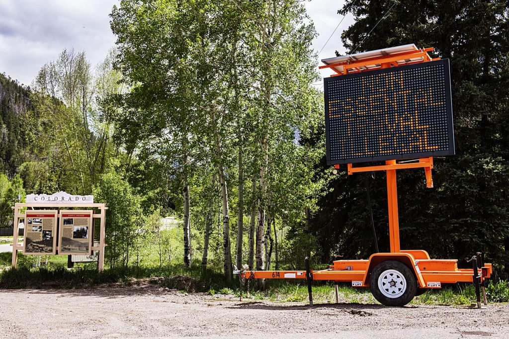 At the Country Road 133 and County Road 3 junction, a sign expresses that nonessential travel in Gunnison County is illegal on Wednesday, May 20, 2020. (Kelsey Brunner/The Aspen Times)