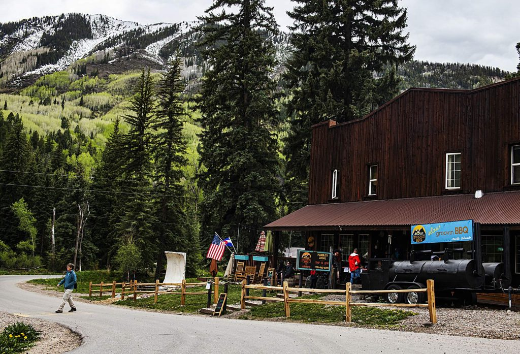 People wait for their food orders outside of Slow Groovin BBQ in Marble on Wednesday, May 20, 2020. (Kelsey Brunner/The Aspen Times)
