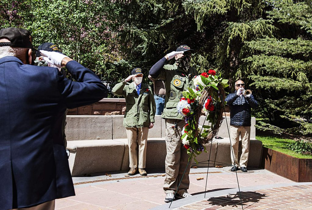 Taps is played as veterans salute the Memorial Day Wreath at the Veterans Memorial in Aspen on Monday, May 25, 2020. (Kelsey Brunner/The Aspen Times)