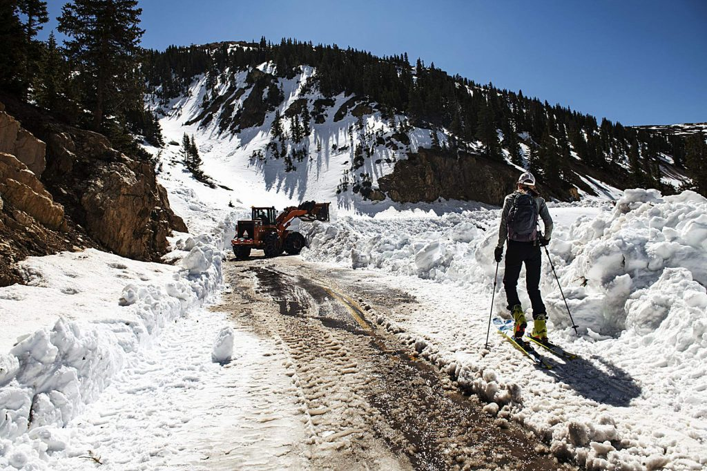 Independence Pass Foundation executive director Karin Teague skins up to where the road is being plowed on the west side of the pass on Tuesday, May 5, 2020.