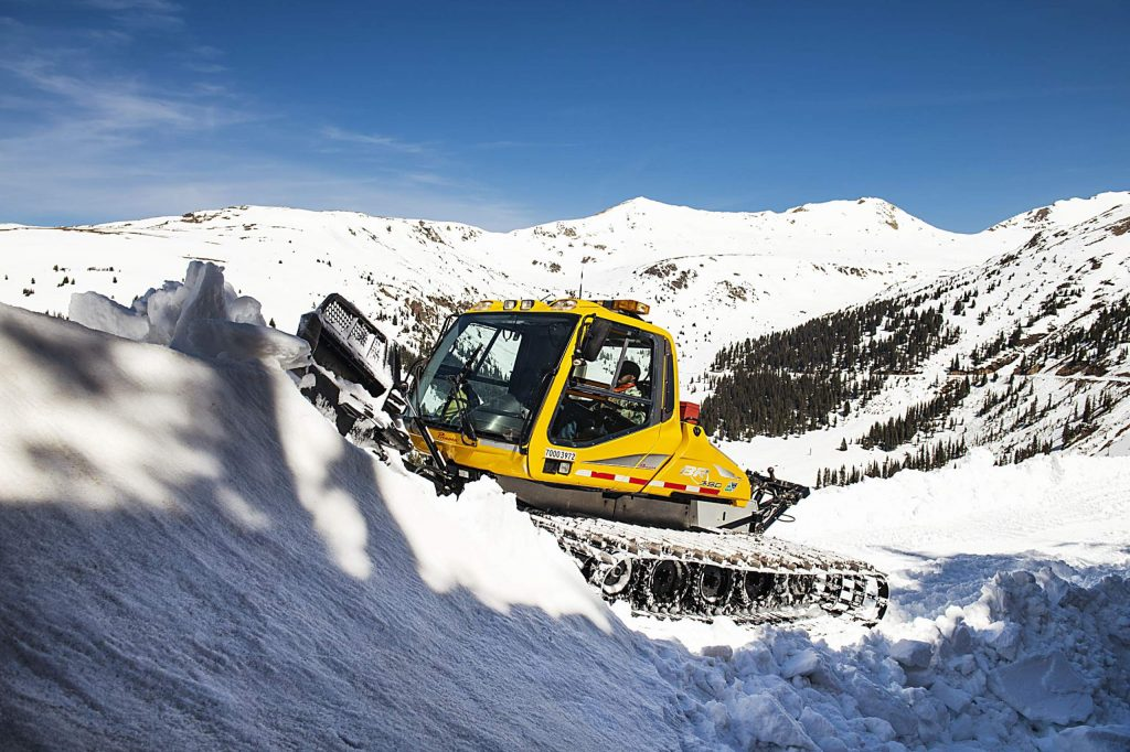 A CDOT snowcat works on the west side of Independence Pass to prepare for an early June opening on Tuesday, May 5, 2020.