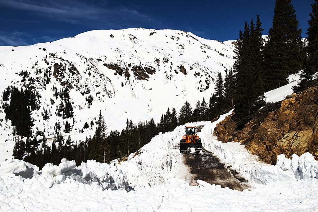 A CDOT plows where the cleared road ends on the west side of Independence Pass on Tuesday, May 5, 2020.