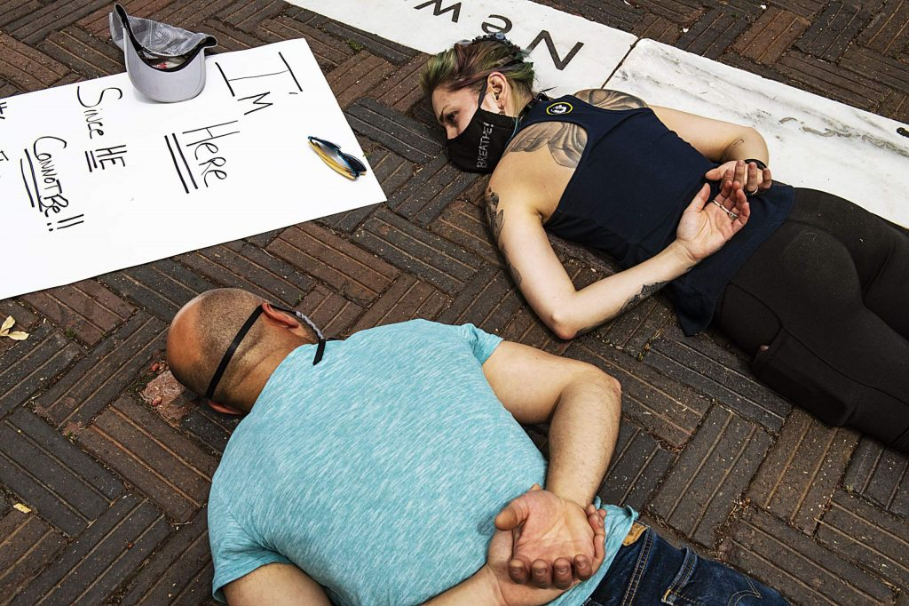 """A protester's mask reads """"I can't breathe"""" as she lays on the ground in honor of George Floyd in Aspen on Sunday, May 31, 2020. (Kelsey Brunner/The Aspen Times)"""
