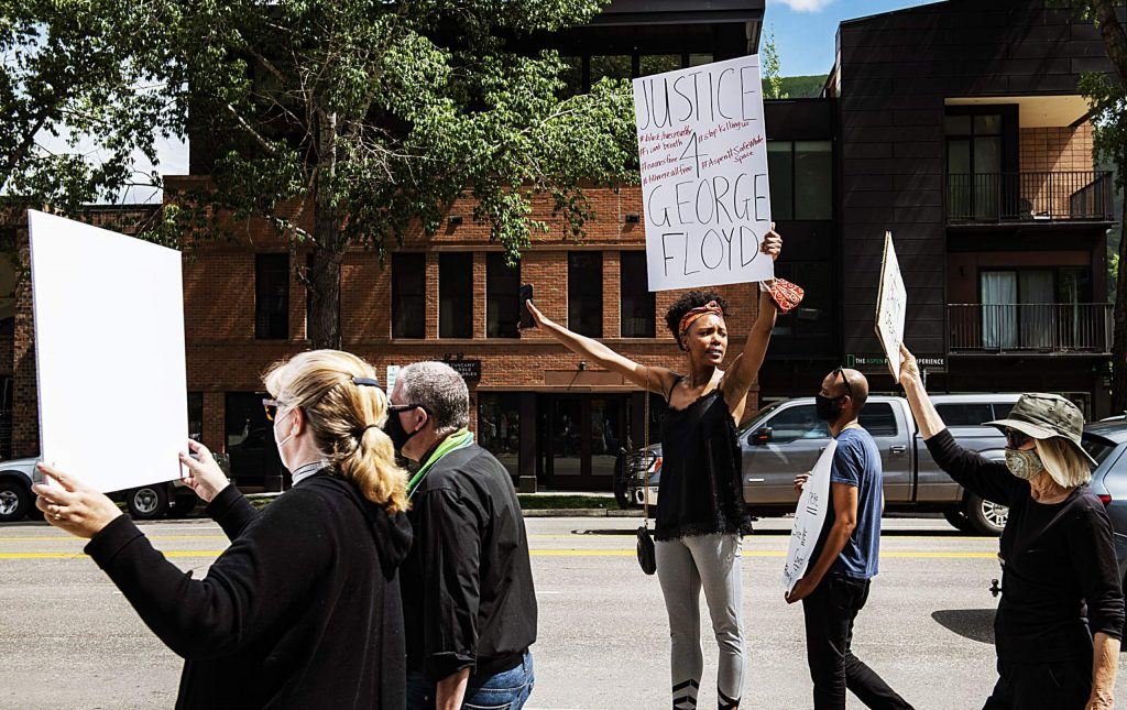 Jenelle Figgins stands on a bench as protesters continue to march for George Floyd in Aspen on Sunday, May 31, 2020. (Kelsey Brunner/The Aspen Times)