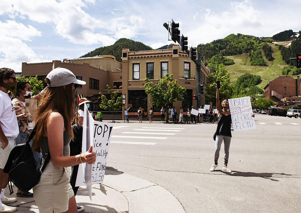 Jenelle Figgins stands in the street chanting with other protesters in Aspen on Sunday, May 31, 2020. (Kelsey Brunner/The Aspen Times)