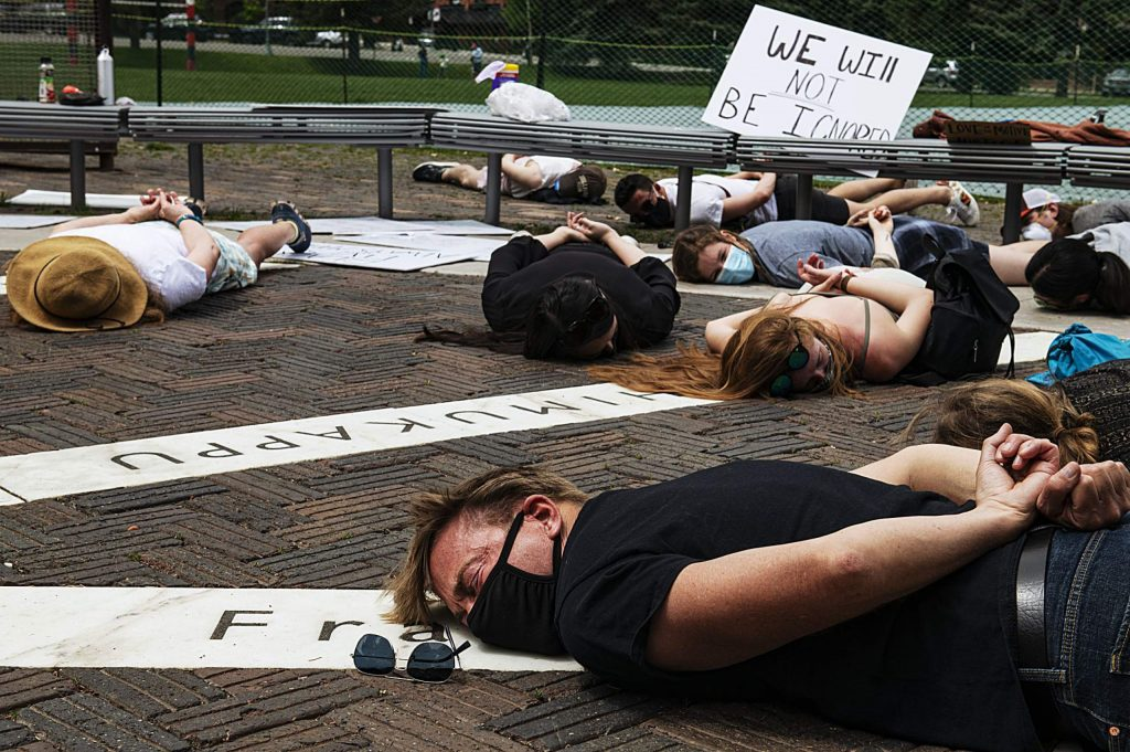 """Protesters lay on the ground in honor of George Floyd as they chant """"I can't breathe"""" for nine minutes in Aspen on Sunday, May 31, 2020. (Kelsey Brunner/The Aspen Times)"""