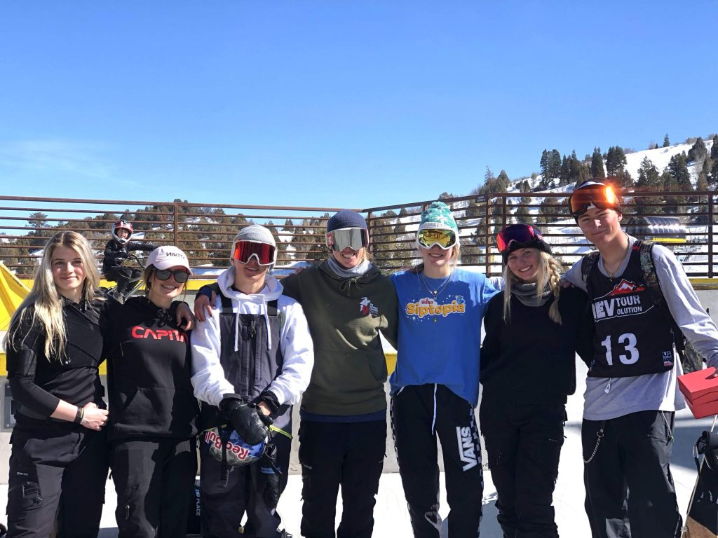 Former AVSC and current U.S. Ski and Snowboard coach Nichole Mason, center, was recently honored by the organization as its coach of the year.
