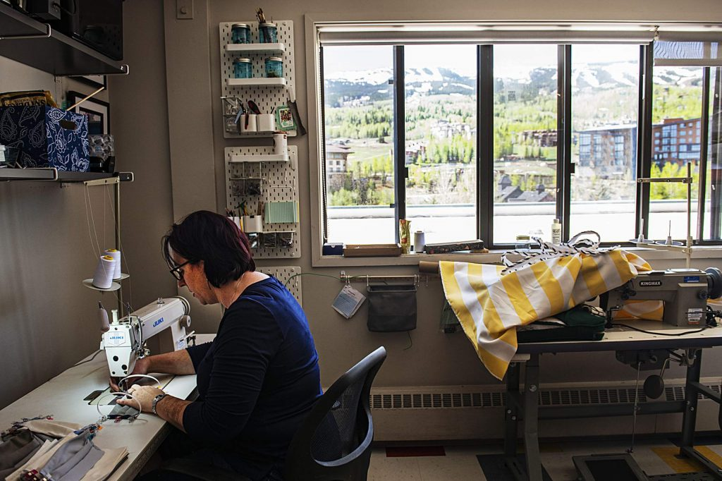 Aimee Ruddell sews a mask in the Slopeside Sewing and Services studio at the Snowmass Center on Monday, May 18, 2020. (Kelsey Brunner/The Aspen Times)