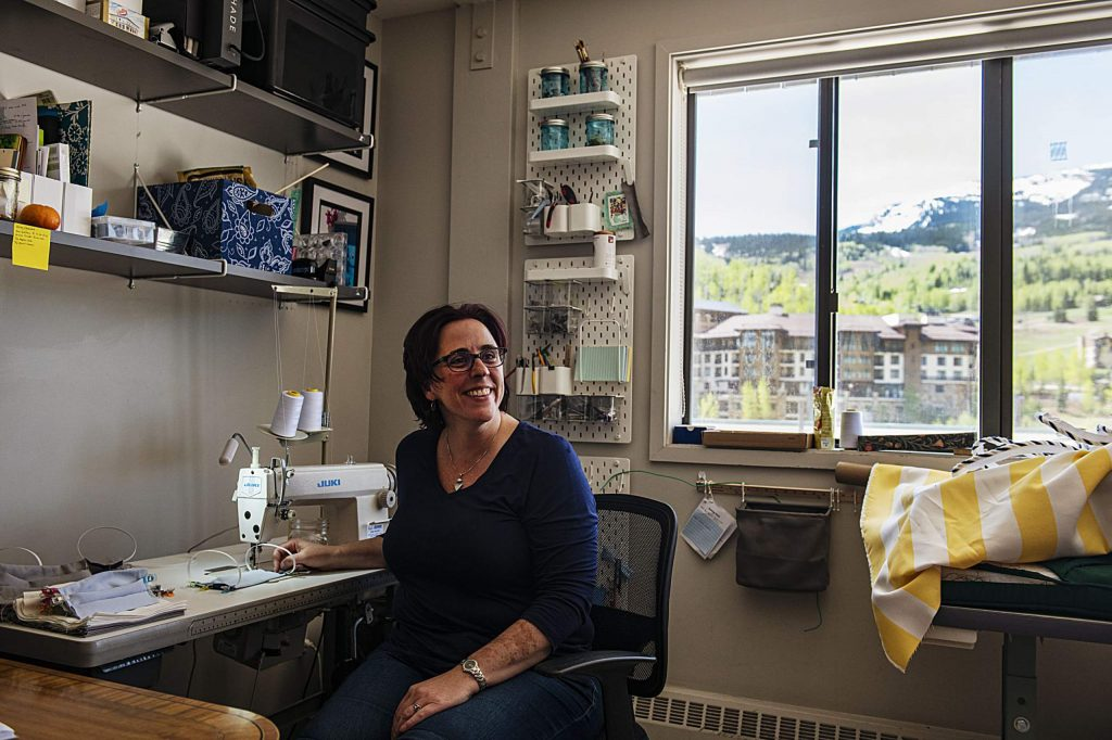Aimee Ruddell sits at her sewing machine in the Slopeside Sewing and Services studio at the Snowmass Center on Monday, May 18, 2020. (Kelsey Brunner/The Aspen Times)
