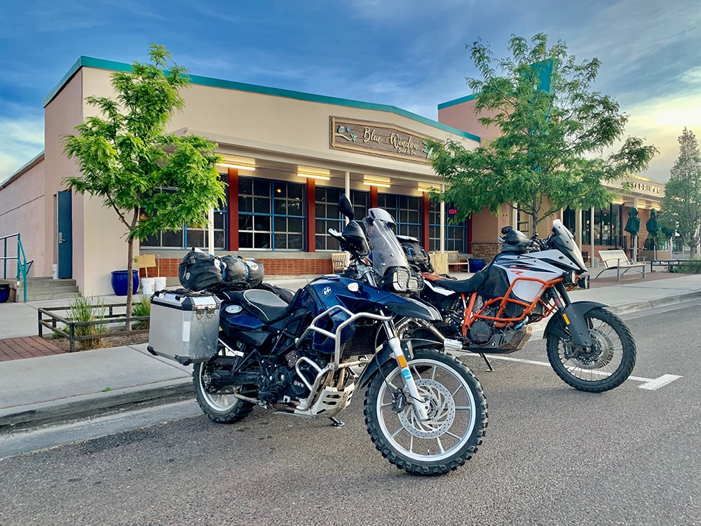 Hans Erickson's BMW F 650 GS (800 twin) and Mike Peabody's KTM 1090 Adventure R parked at their friend's restaurant in Los Alamos.