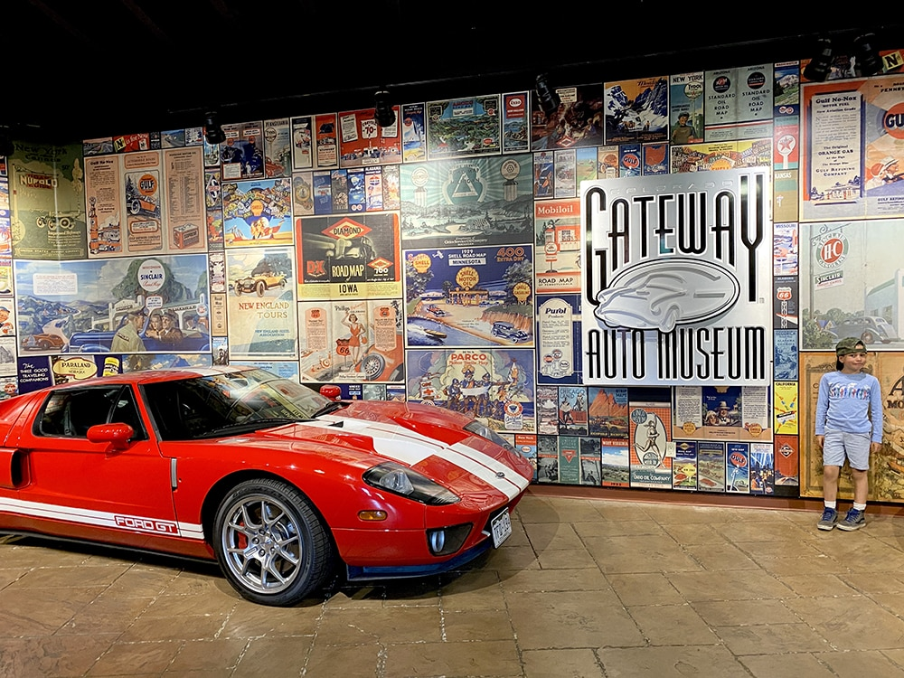 Charles Remington checking out a Ford GT 350, the car that beat Ferrari, at Gateway Museum in Gateway, Colo.