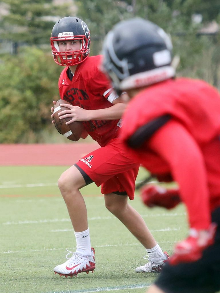 Aspen High School quarterback Tyler Ward eyes a receiver during football practice on Wednesday, Aug. 22, 2018. (Photo by Austin Colbert/The Aspen Times).
