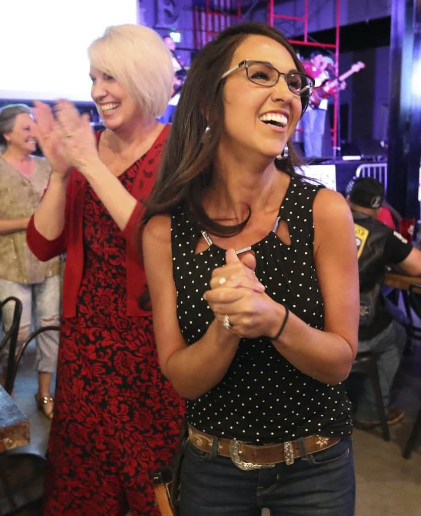 Businesswoman Lauren Boebert, right, and Janet Rowland, left, react to early returns during a watch party in Grand Junction, Colo., after polls closed in Colorado's primary Tuesday, June 30, 2020. Boebert defeated five-term Rep. Scott Tipton in the Republican primary in the state's 3rd Congressional District. (Christopher Tomlinson/The Grand Junction Daily Sentinel via AP)