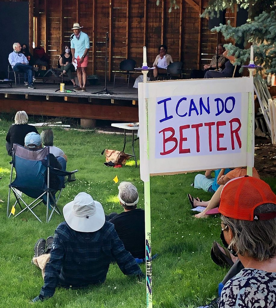 Basalt resident Ed Troy addresses an audience of about 150 people in Basalt attending a