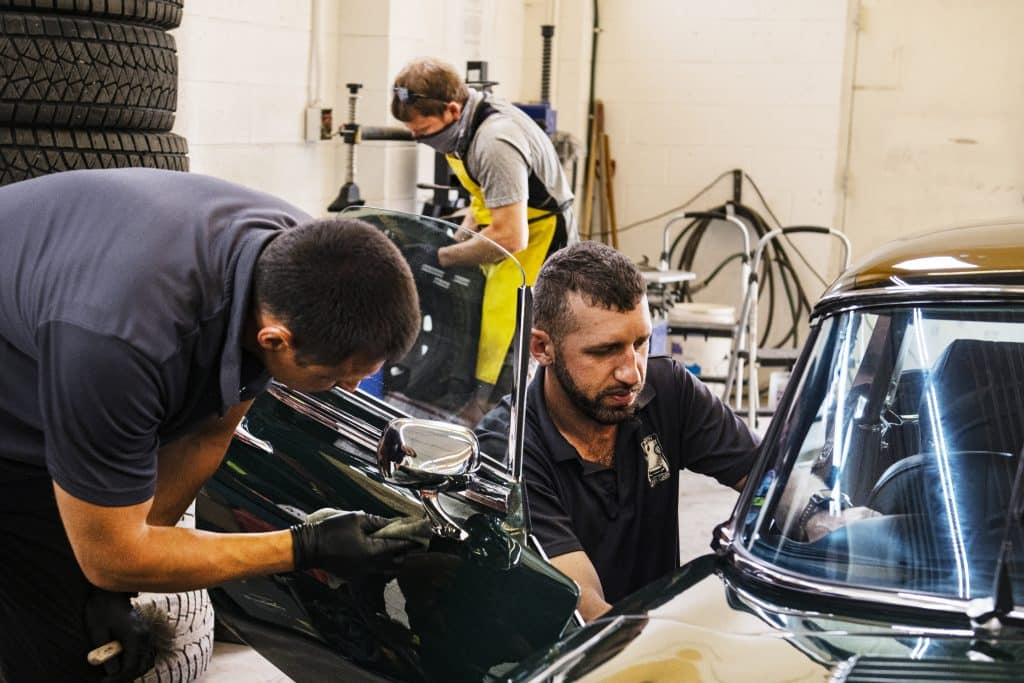 Vitaly Sudakov, left, Rusaln Faradzhouv and Michael Mosenz work in the Aspen Car Care — Super Shine Plus Detailing shop in the Aspen Airport Business Center on Tuesday, May 26, 2020.