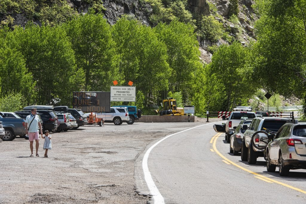 Cars line up before the official opening of the Independence Pass gate before noon in Aspen on Monday, June 1, 2020.