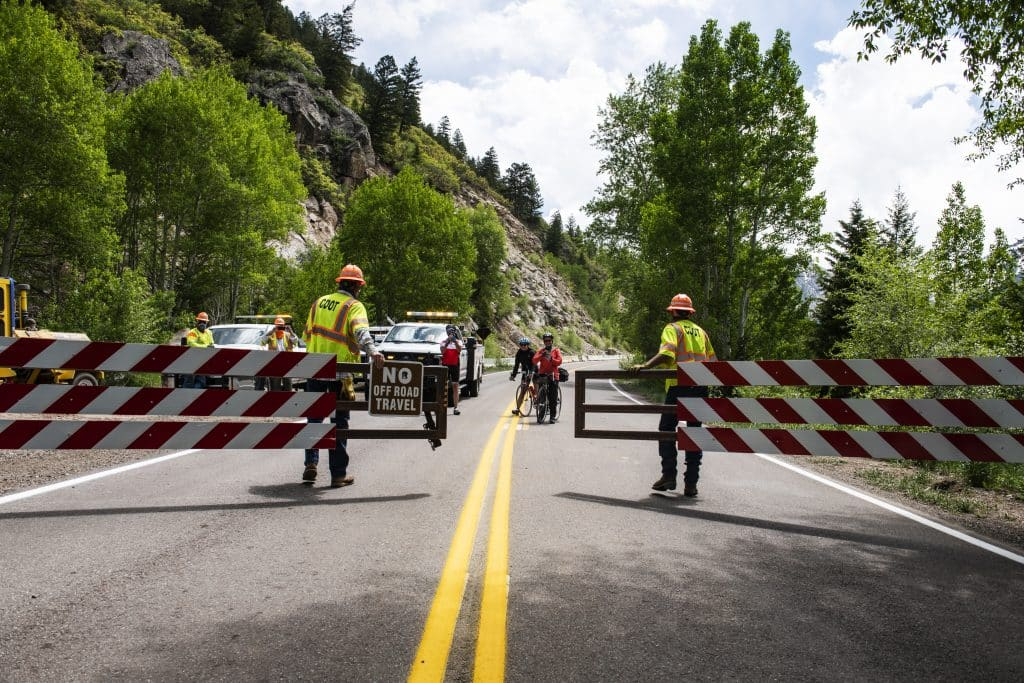 Bikers wait on the otherwise of the Independence Pass gate as the Colorado Department of Transportation open the road to vehicle traffic for the summer on Monday, June 1, 2020.