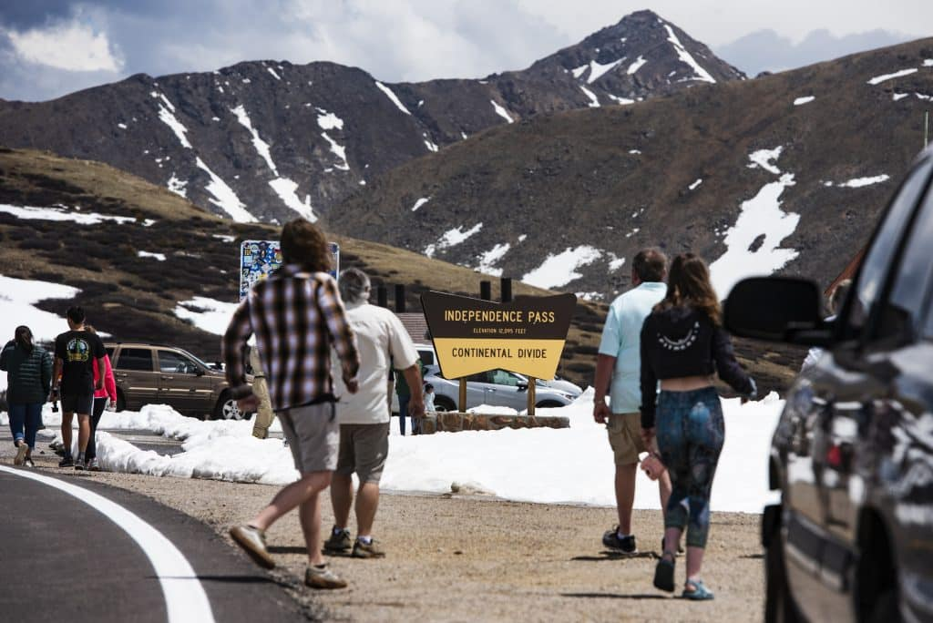 People mill around the summit of Independence Pass on opening day for the summer on Monday, June 1, 2020.