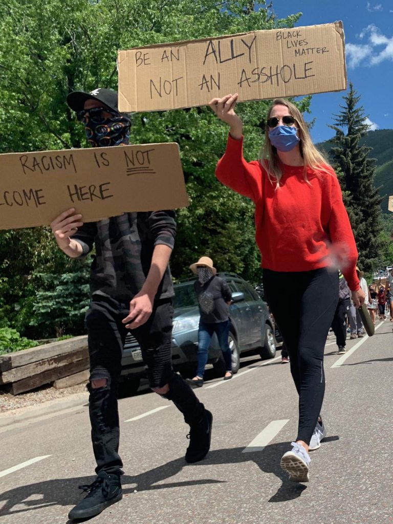 Marchers walk down Aspen St. toward Wagner Park chanting and waving signs during a Black Lives Matter protest on Sunday, June 7, 2020, in Aspen. (Photo by Austin Colbert/The Aspen Times)