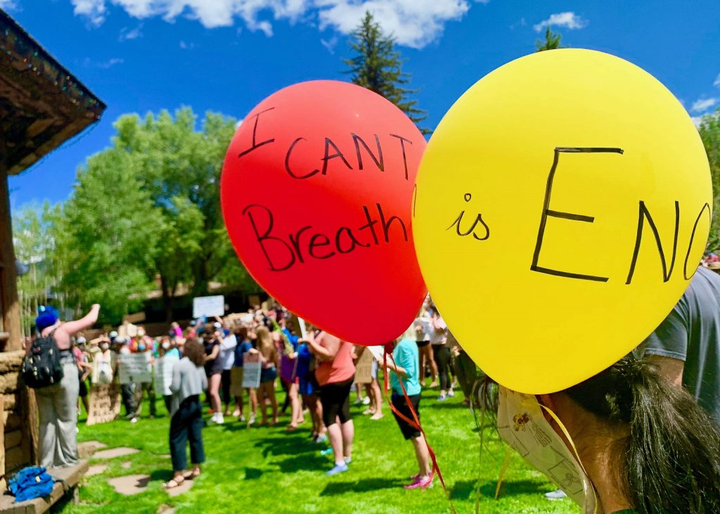 A marcher used balloons to deliver a few messages, including
