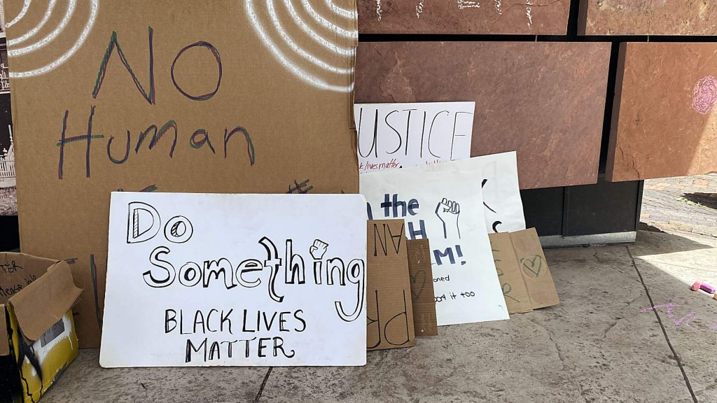Signs were available for those who didn't bring them Sunday to the march in Aspen.