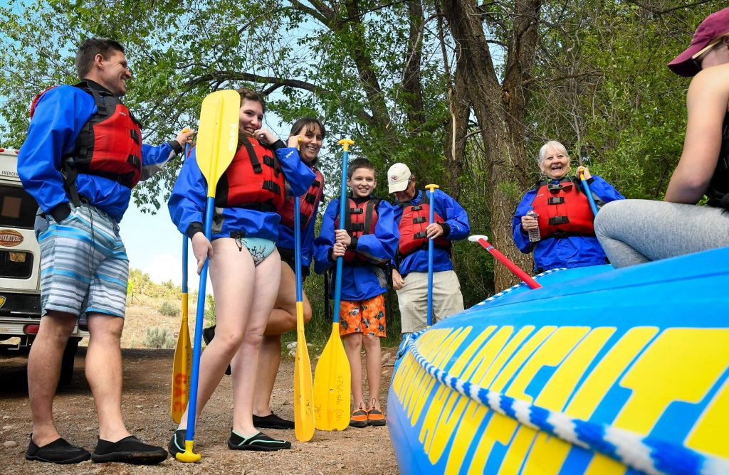 The Paxia family and Goodwins listen in during a safety talk with their guide before floating down the Roaring Fork River with Glenwood Adventure Company on Tuesday afternoon.
