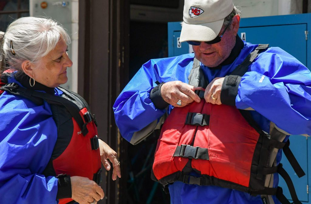 Glen and Linda Goodwin from Missouri make sure their life jackets fit properly before heading out for a rafting trip with Glenwood Adventure Company.