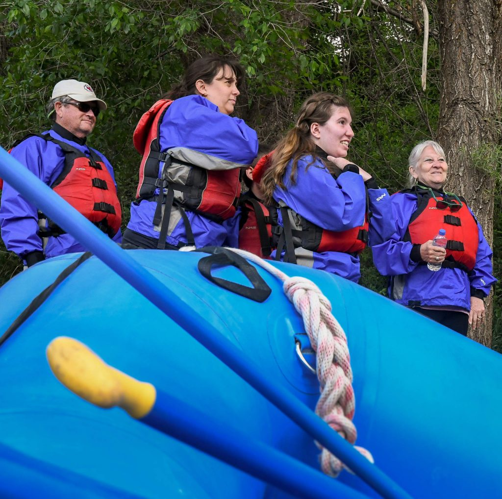 A group of rafters listen in to their guide before floating down the Roaring Fork River on Tuesday afternoon.