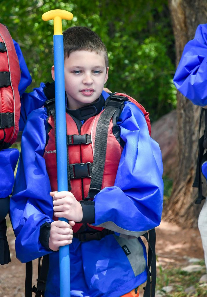 Noah Paxia listens to his raft guide before floating down the Roaring Fork River with his family on Tuesday afternoon.