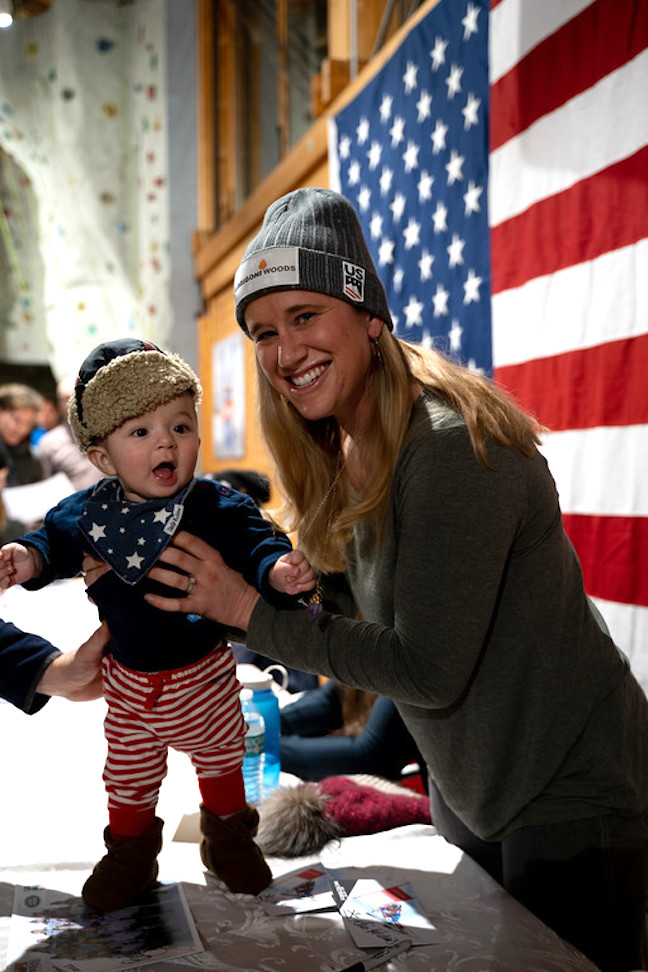 U.S. ski team member Alice McKennis greets a child during a fan event.