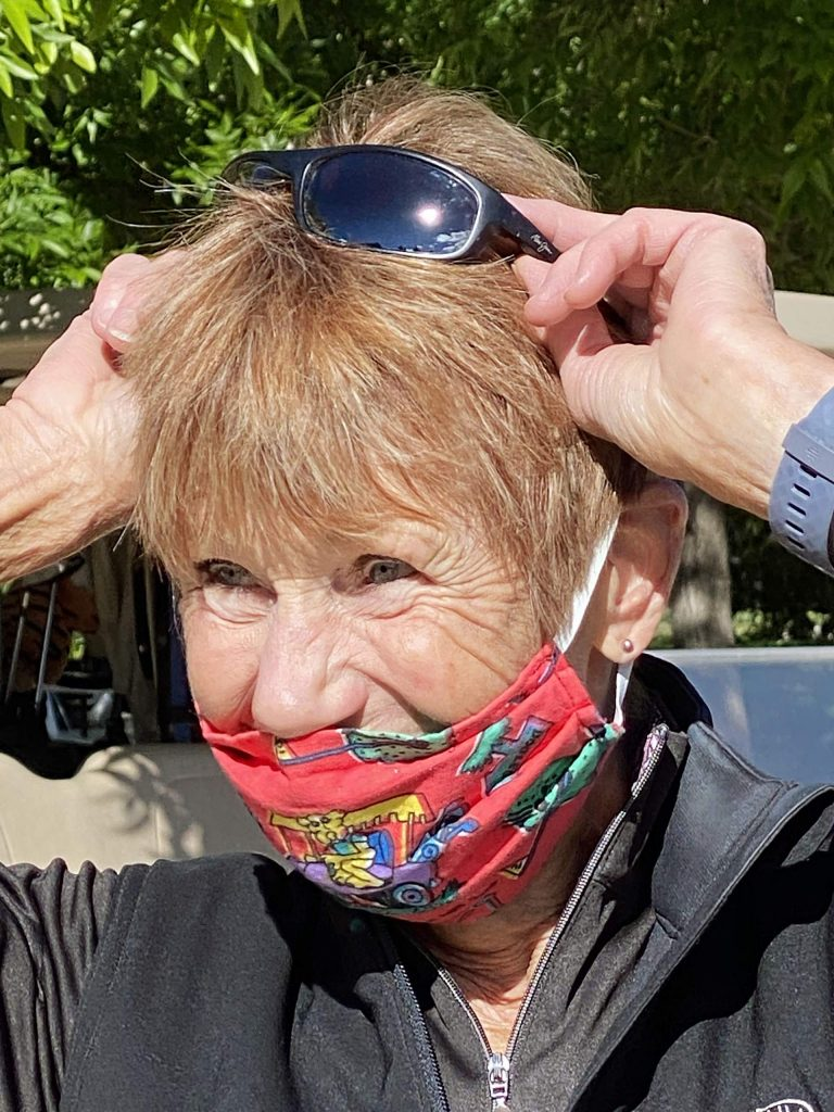 Anne Pratt dons a mask before hitting the links at Aspen Golf Club.