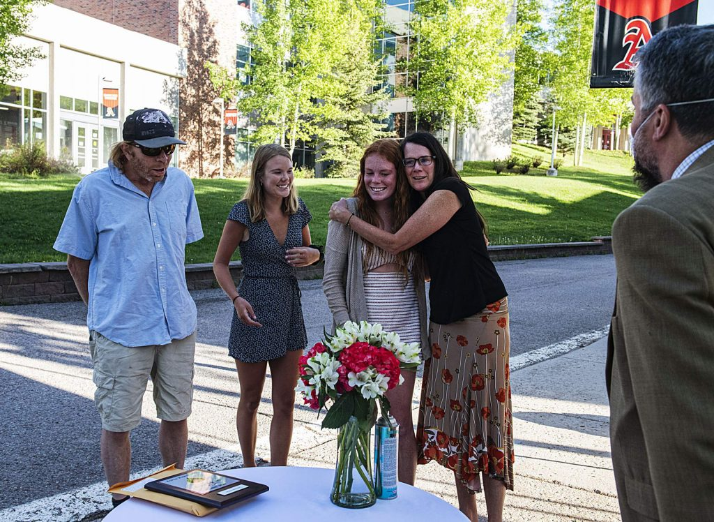 Maeve McGuire and her family react after she was announced as one of two female athletes of the year during Aspen High School's scholarship drive-though event on Thursday, May 28, 2020. (Kelsey Brunner/The Aspen Times)