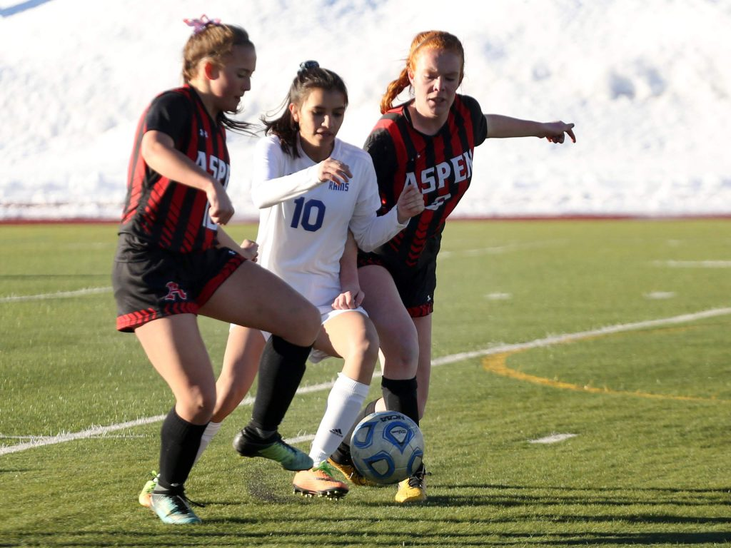 Aspen High School's Maeve McGuire, right, defends in a girls soccer game Roaring Fork on Tuesday, March 19, 2019, on the AHS turf. (Photo by Austin Colbert/The Aspen Times).