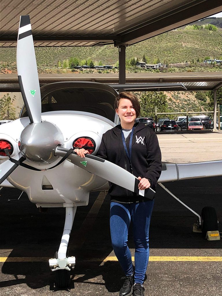 Hannah Popish, 16, smiles for a photo after going on her first solo flight this past school year.