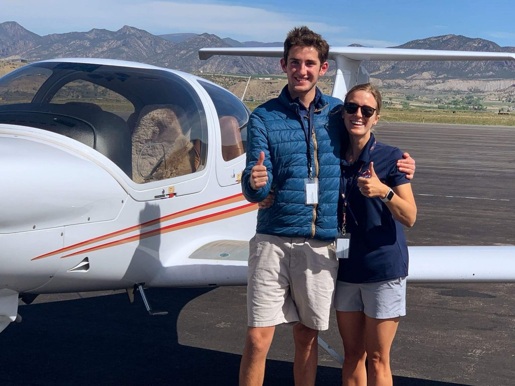 Robert Holtom, 16, stands with Kate Short, aviation director for Aspen High School, after completing his first solo flight this past school year.