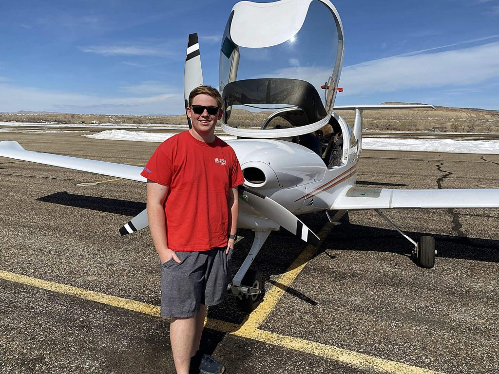 Evan Pearce, 18, stands for a photo with one of the Aspen Flight Academy's Diamond DA 40 single-engine airplanes. Pearce graduated from Aspen High School on May 30 and plans to attend Purdue University this fall to study aviation.